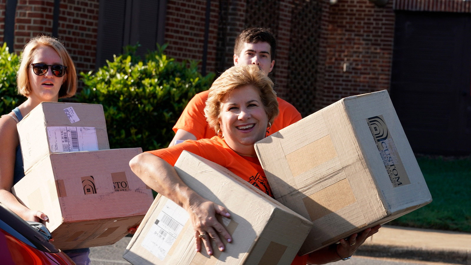 Mrs. Downs moving boxes