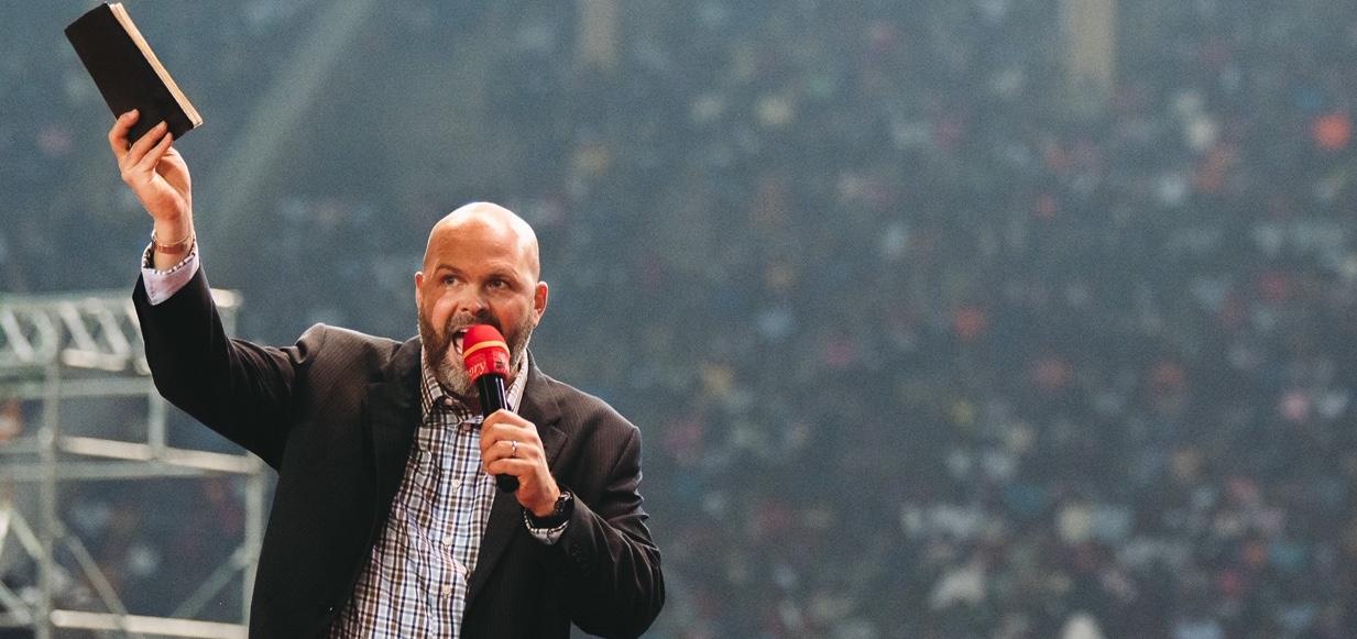 Clayton King teaching in Uganda in Mandela Stadium