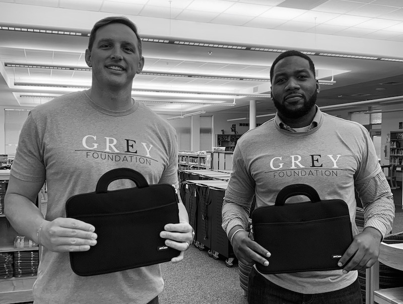 Matt Skeen, left, and Chris James pose at the school with the Chromebook covers.