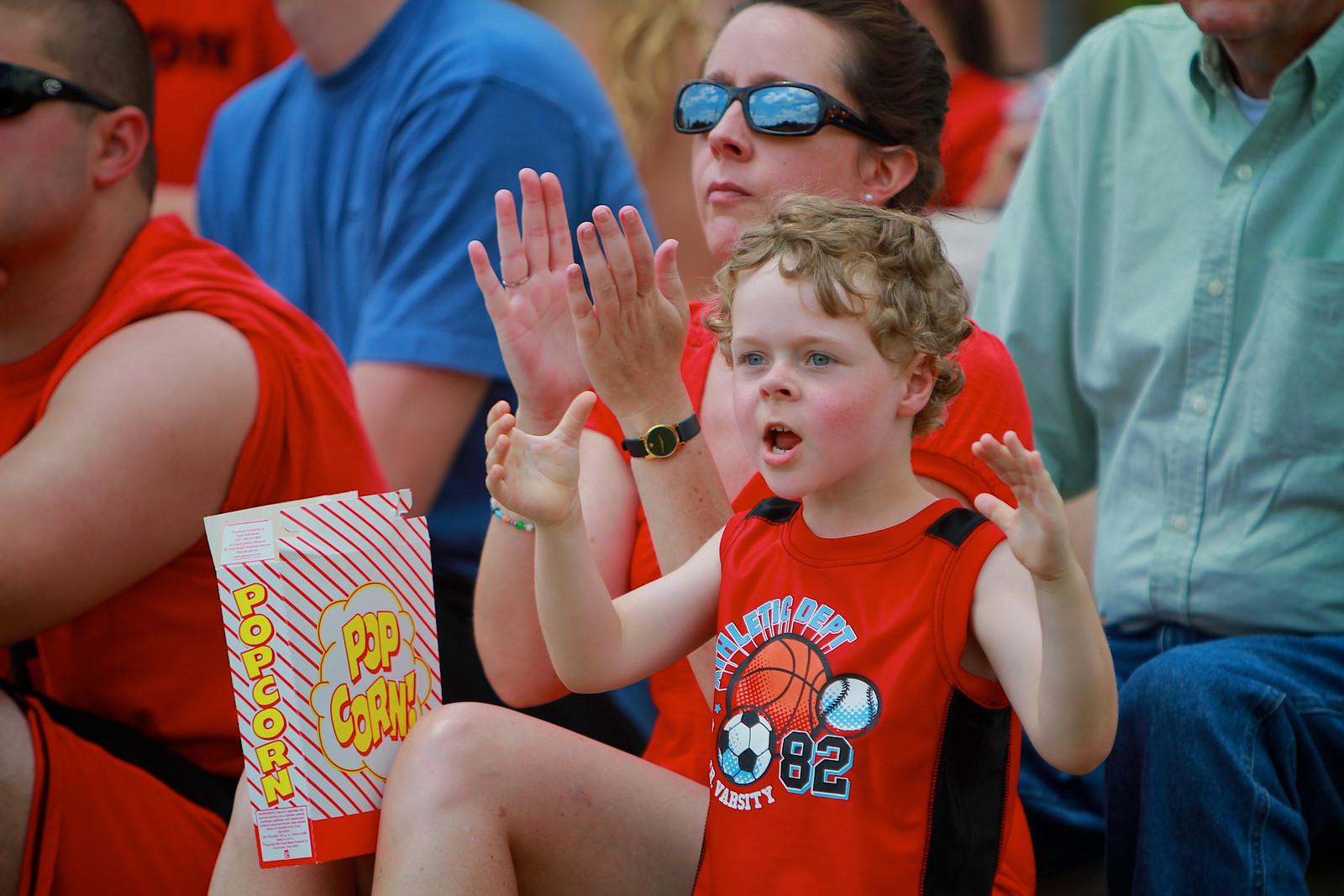 Child cheering at baseball game
