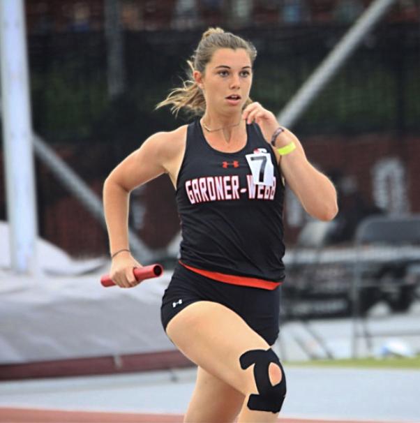 Women's Track and Field relay runner