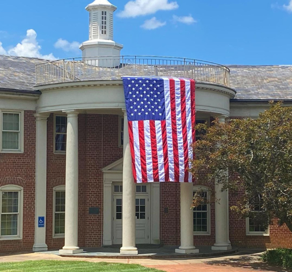 flag hanging at Webb Hall on Independence Day