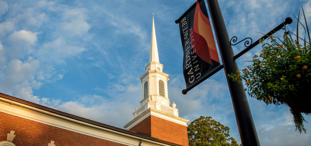 A the steeple on Dover Chapel with a GWU banner in the foreground